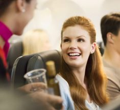 When are (alcoholic) drinks complimentary on domestic flights?