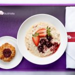 Bircher muesli with cherry compote, served with a Danish pastry