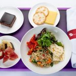 Haloumi and quinoa salad served alongside an antipasto plate with marinated vegetables, cheese and crackers and a chocolate delight cake